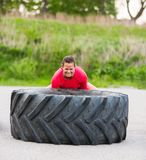 Dedicated Woman Lifting Tire Stock Photos