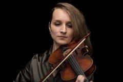 Dedicated woman playing a Baroque violin