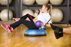 Dedicated woman trains abdominal exercise for core strength Royalty Free Stock Photography