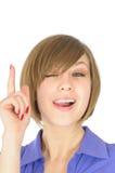 Dedo atractivo de la demostración una de la muchacha imagen de archivo libre de regalías