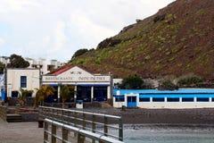 Dedo de Dios, Agaete, Gran Canaria. Restaurant in Agaete, on the beach  near famous rock formation Dedo de Dios God`s finger  located in the Atlantic Ocean at Stock Images