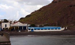 Dedo de Dios, Agaete, Gran Canaria. Restaurant in Agaete, on the beach  near famous rock formation Dedo de Dios God`s finger  located in the Atlantic Ocean at Royalty Free Stock Image