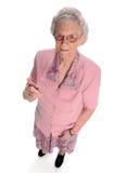 Dedo de Pinting de una más vieja mujer Fotografía de archivo