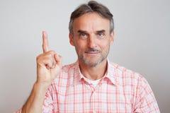 Dedo do diretor empresarial do alto executivo acima Fotografia de Stock Royalty Free