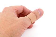 Dedo e atadura Foto de Stock