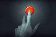 Dedo en el botón rojo Imagen de archivo