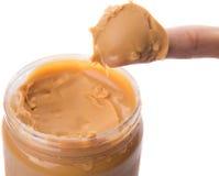 Dedo fêmea com manteiga de amendoim mim Imagens de Stock Royalty Free