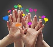 Dedo feliz com bolhas do discurso do coração do amor Fotografia de Stock Royalty Free