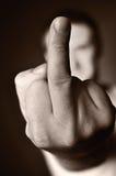 Dedo médio como um sinal da agressão. Fotografia de Stock