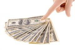 Dedo que señala a los dólares Imagen de archivo libre de regalías