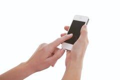Dedo que toca la pantalla de Smartphone Foto de archivo libre de regalías