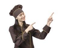 Dedos alegres dos pontos do cozinheiro ao lado fotos de stock royalty free