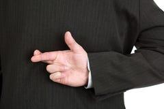Dedos cruzados Foto de archivo