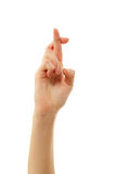 Dedos cruzados aislados en blanco Imagen de archivo