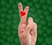 Dedos cruzados fazendo a pose romântica Fotografia de Stock