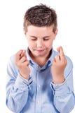 Dedos da criança cruzados Fotos de Stock