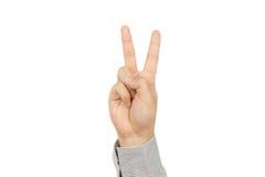 Dedos da mostra dois da mão de homem de negócio Foto de Stock Royalty Free