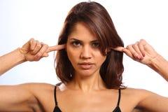 Dedos de la mujer joven en los oídos que no escuchan Fotografía de archivo libre de regalías