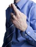 Dedos do cruzamento do homem de negócio Fotografia de Stock Royalty Free