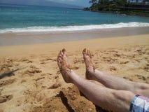 Dedos do pé na areia fotos de stock