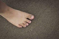 Dedos do pé na praia Imagem de Stock