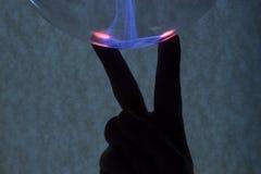 Dedos e plasma Foto de Stock