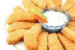 Dedos e veggies dourados da galinha Imagens de Stock