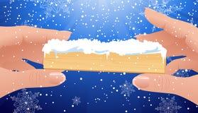 Dedos humanos que llevan a cabo el marco de la Navidad Imagen de archivo libre de regalías