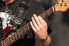 Dedos nas cordas Fotografia de Stock