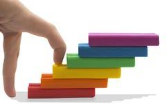 Dedos que andam acima das escadas. Fotografia de Stock Royalty Free