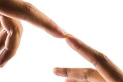 Dedos tocantes da mão dos homens com a mulher no fundo branco Fotos de Stock Royalty Free