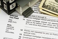 Deduca l'interesse da contratto ipotecario sulle tasse Fotografia Stock