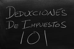Deducciones De Impuestos 101 On A Blackboard. Translation: Tax Deductions 101 stock image
