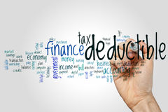 Deductible word cloud. Concept on grey background stock images