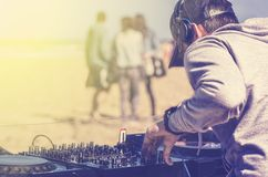 Dee Jay mixing at beach party Royalty Free Stock Photo