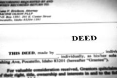 Deed to Real Estate Transfer Title. Ownership to land or home stock photo