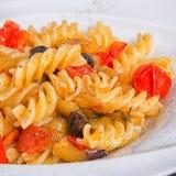 Deegwarentomaten en aubergines Stock Fotografie
