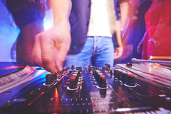 Deejay adjusting sound Royalty Free Stock Photography