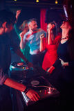 Deejay and dancing girls Royalty Free Stock Photography
