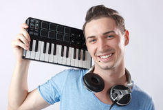 Deejay with headphones and midi keyboard Stock Photography