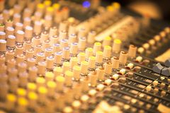 Deejay live music mixing desk. Deejay live electronic dj music mixing desk with buttons and controls in Ibiza house disco party Royalty Free Stock Photo