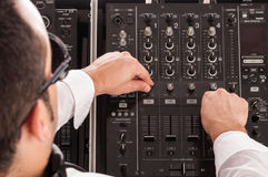 Deejay man. Man deejay by mixing music with music table Royalty Free Stock Photography