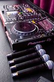 Deejay mixing desk and microphones stock photo
