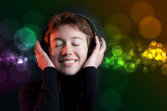 Deejay party girl with colorful bokeh Stock Images