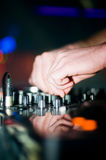 Deejay's hand and turntable Stock Image