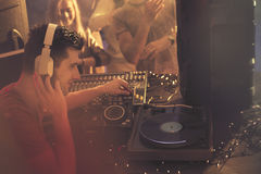 Deejay sitting beside turntable. Deejay sitting beside vinyl turntable, playing at nightclub Stock Images