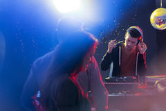 Deejay at turntable. Giving concert at nightclub Royalty Free Stock Photo