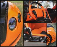 Deel oranje auto op asfaltachtergrond Oranje luxeauto royalty-vrije stock afbeeldingen