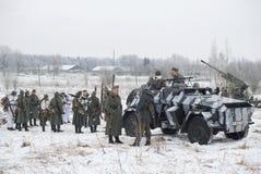 Deelnemers in de militair-historische festival` Januari Donder ` in de vorm van het Duitse leger vóór de wederopbouw van hos Royalty-vrije Stock Foto's