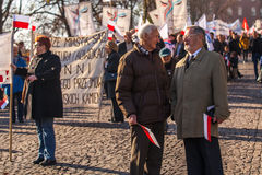 Deelnemers die Nationale Onafhankelijkheidsdag vieren een Republiek Polen - is een officiële feestdag, Royalty-vrije Stock Afbeeldingen